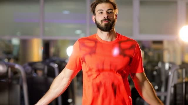 Handsome muscular man with jumping rope video