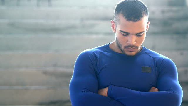 Handsome, muscular, mixed race young man, serious video
