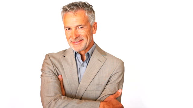 vídeos de stock, filmes e b-roll de bonito homem de negócios sênior sorrindo - fundo branco