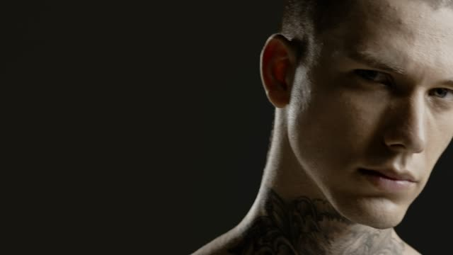handsome sexy young man stylish with tattoo on his neck, torso and hand - ultra close up body and face detail - greenscreen prores - cinematic lighting - tatuaggio video stock e b–roll