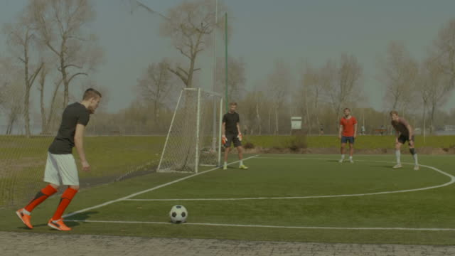 Handsome soccer player hitting ball with head video