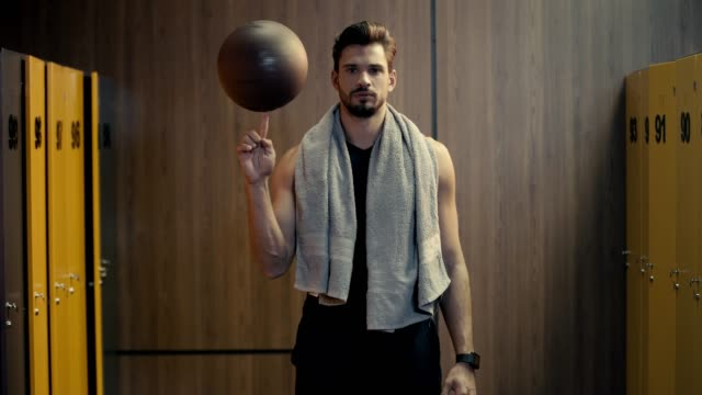 handsome sportsman spinning basketball in finger handsome sportsman spinning basketball in finger sportsperson stock videos & royalty-free footage