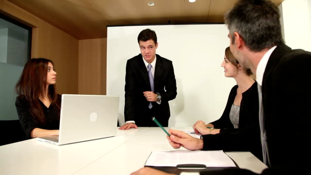 Handsome young business boss holds meeting with small group video