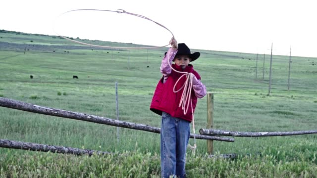A Handsome Young Cowboy Practicing His Roping Skills