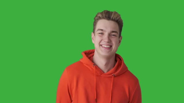 Handsome young man against green background video
