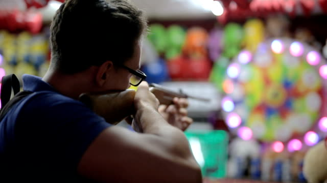 Handsome young man aiming at a target