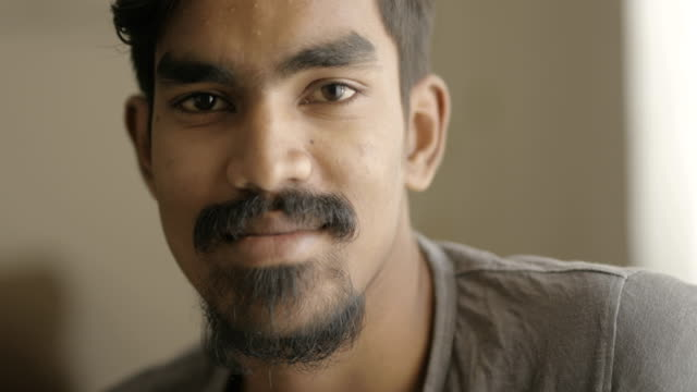 Handsome young man smiling Handsome young man smiling at the camera. indian culture stock videos & royalty-free footage