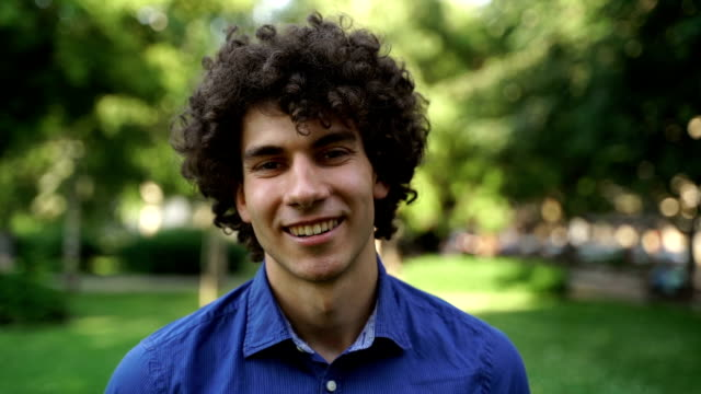 handsome young man,portrait - sorriso aperto video stock e b–roll