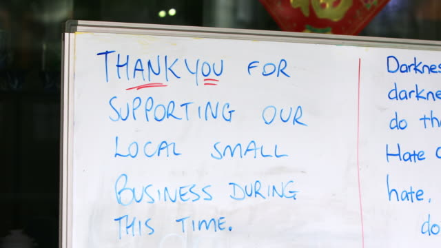 Handwritten Thank You Sign On Retail Store During Covid-19