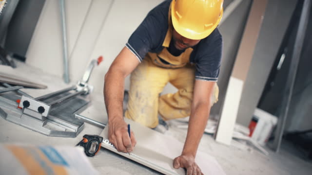 Handyman cutting ceramic tiles. video