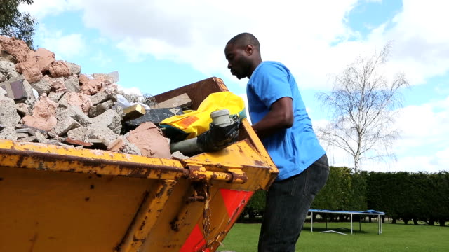 Handyman Empty Rubble into Skip video