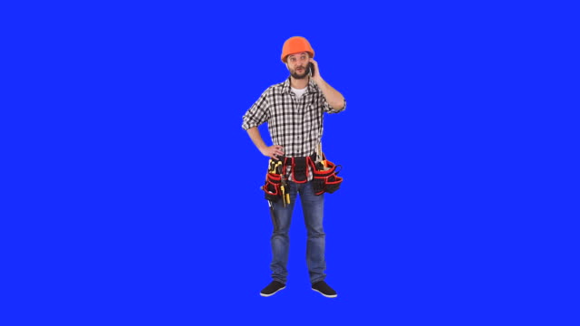 Handyman talks on mobile phone video