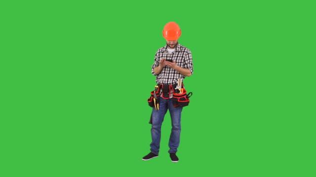 Handyman using on mobile phone video
