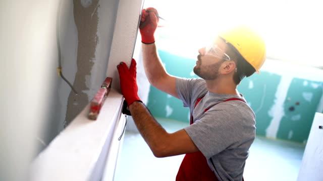 handyman working indoors. - imprenditore edile video stock e b–roll