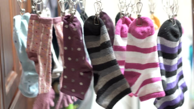hang out the socks to dry. - calzino video stock e b–roll