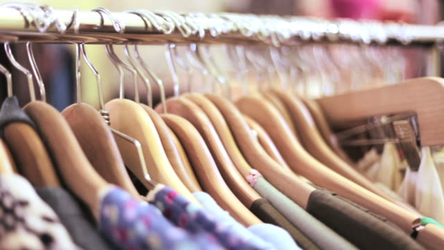 Hangers on a rail in fashion boutique video