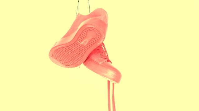 stockvideo's en b-roll-footage met opknoping fel gekleurde sneakers. mode vrouw trendy trainers. stijlvolle hipster plimsole fel geel koraal kleur sneakers. minimal pop art concept. psychedelisch vlak lag. art design achtergrond. vaporwave stijl - running shoes