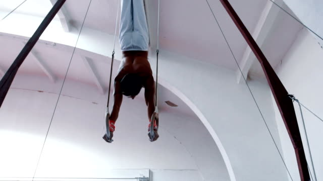 Hanging from gymnastics rings video