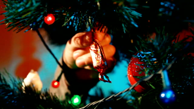 Hanging Ornaments on a Christmas tree video
