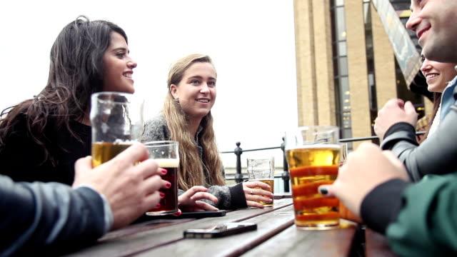 hanging out with a fresh beer in a london pub - pub bildbanksvideor och videomaterial från bakom kulisserna