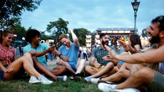 hanging out with friends before the concert. - pokolenie y filmów i materiałów b-roll