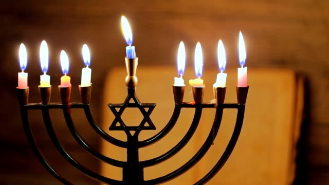 Hanukkah menorah with burning candles. Retro old style video