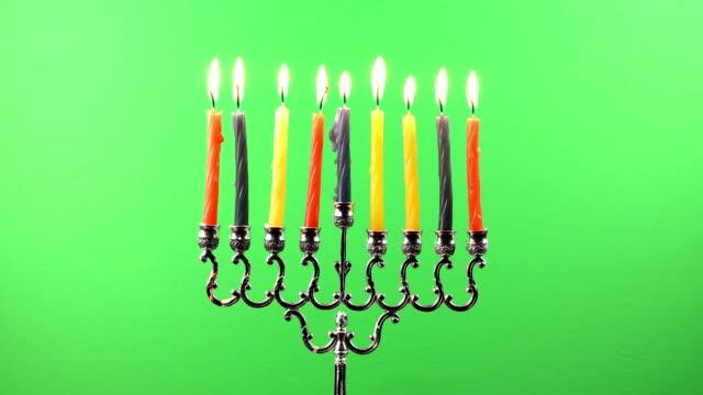 Hanukkah menorah with candles on greenscreen video