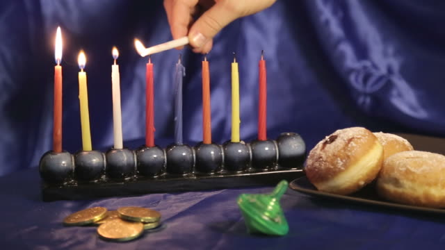 Hanukkah table with menorah and colorful candles video