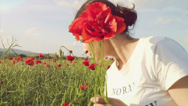 Happiness in a field with poppies. video