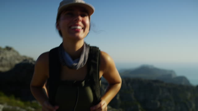 happiness is found on top of a mountain - trekking video stock e b–roll