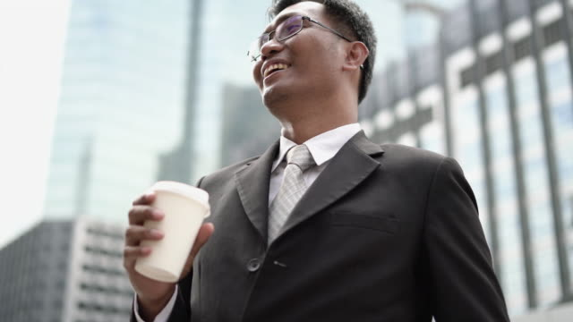 Happiness of Businessman drinking coffee and smile.