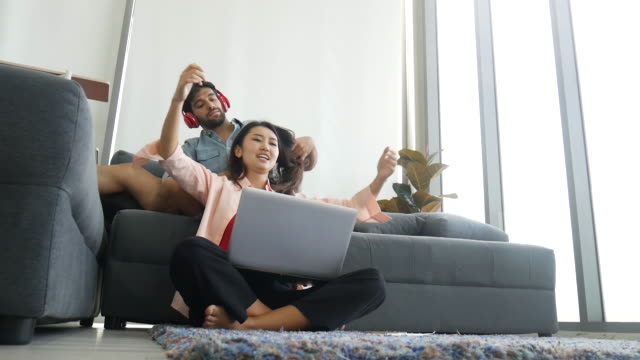 vídeos de stock e filmes b-roll de happiness young couple lover working from home and stay home for protection from corona virus. - remote work