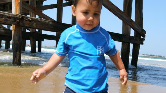Happy Aboriginal Australian Boy Playing at the Beach video