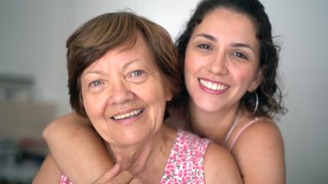 Happy adult mother and daughter embracing