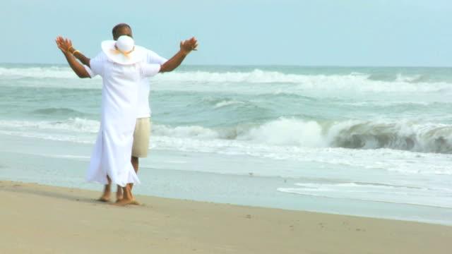 Happy African American Couple Dancing Beach video