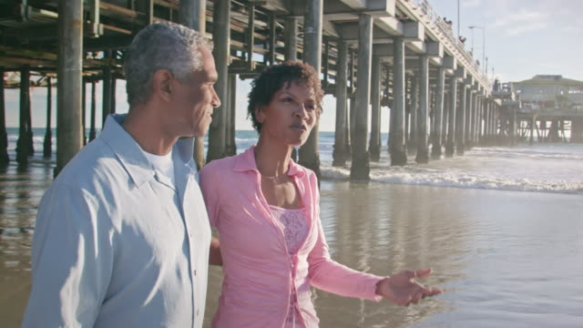 Happy African American Couple Walk and Talk Along the Beach video