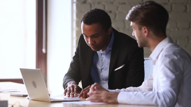 Happy african client handshake caucasian manager sign business contract Happy african american client candidate handshake caucasian manager sign contract at business meeting get hired or buy services take bank loan, black customer and broker dealer shake hands make deal loan stock videos & royalty-free footage