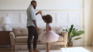 istock Happy african dad dancing with his child daughter princess 1173181710