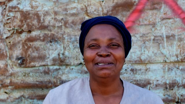 Happy African woman A real African woman smiling and laughing, Kayamandi South Africa western cape province stock videos & royalty-free footage