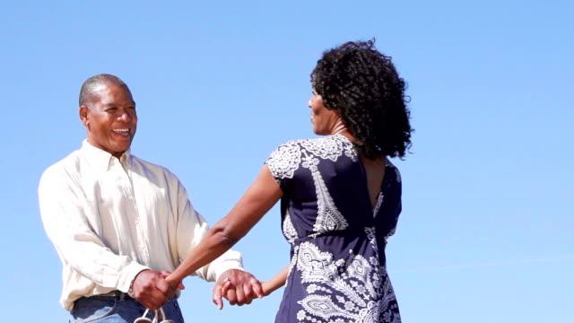 happy afro american couple - mänsklig ålder bildbanksvideor och videomaterial från bakom kulisserna