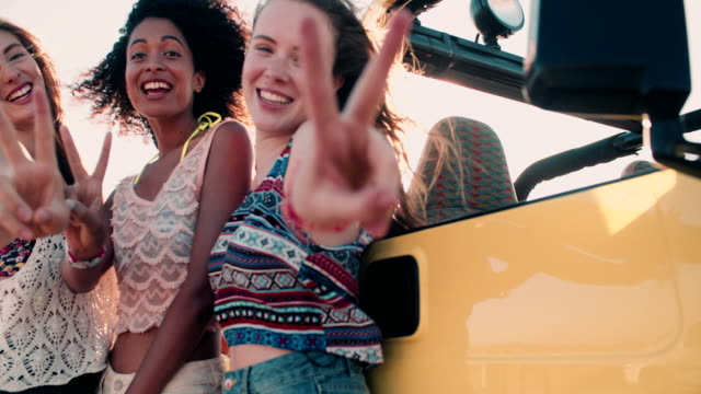 Happy Afro girl and friends smiling showing peace sign video