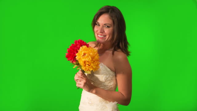 Happy and beautiful bride holding flowers. Shot on Green Screen. video
