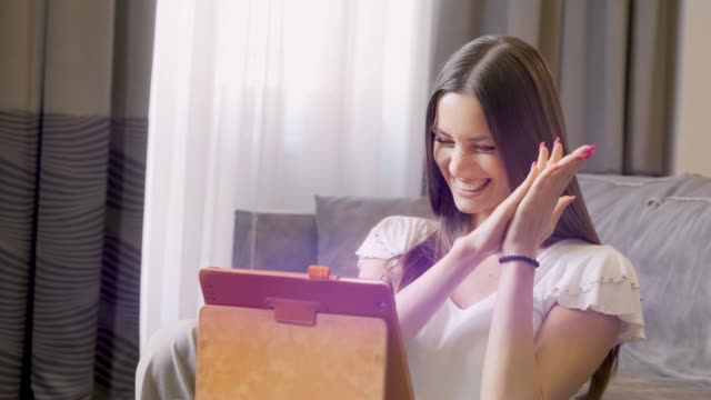 Happy and Excited Girl in Bad Celebrating Success. Using Digital Tablet. video