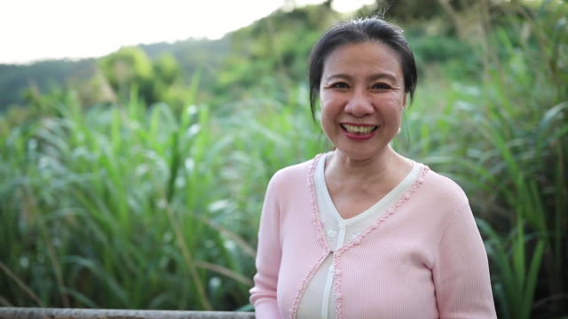 Happy And Healthy Portrait of a senior Asian woman outdoors. ethnicity stock videos & royalty-free footage