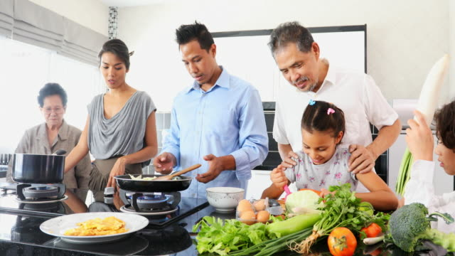 happy asian family cooking together in the kitchen - thai food stock videos and b-roll footage