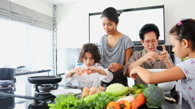 Happy Asian Family Cooking Together in the Kitchen video