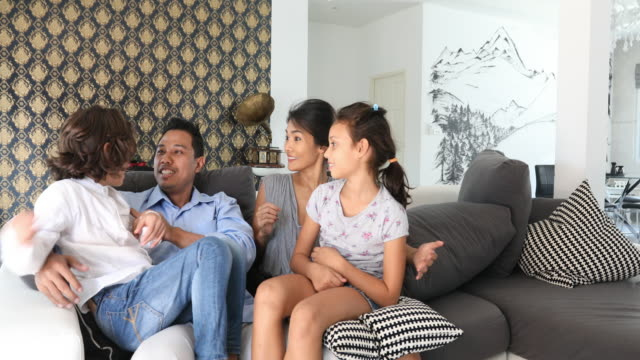 Happy Asian Family Having Fun on the Sofa video