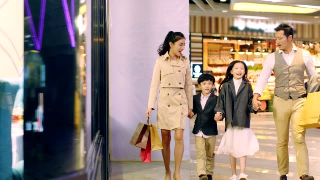 happy asian family walking in shopping mall happy asian family with two children walking hand in hand in shopping mall east asia stock videos & royalty-free footage