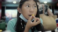 istock Happy Asian girl eating French Fried in junk food restaurant with family, lifestyle concept. 1316562826