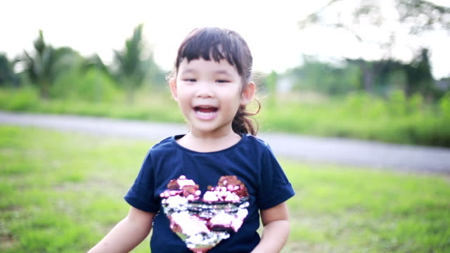 Happy Asian girl jumping and clapping video